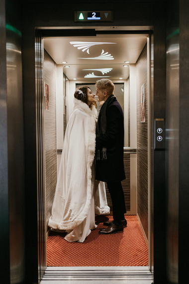 Newlyweds kissing during their winter wedding elopement to Denmark for their small wedding abroad.