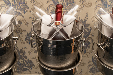 A champagne bottle and glasses, one of the many details included in our romantic elopement packages abroad for couples that want to elope to Denmark.