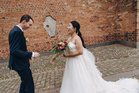 Newlyweds having fun during their wedding day, organized by one of our Denmark elopement packages.