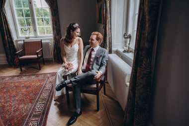 A romantic moment between newlyweds during their Scandinavian wedding adventure at Vindeholme Castle.