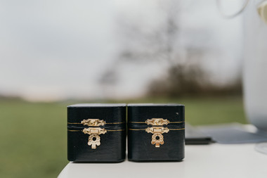 The ring boxes that the newlyweds brought with them to their adventure wedding so they can get married in Denmark.