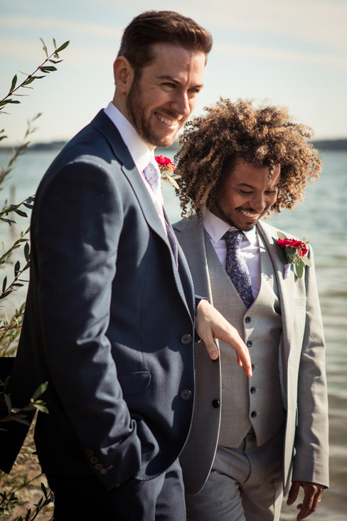 A newlywed couple smiling during their same-sex wedding in Denmark, one of the best places to get married abroad.