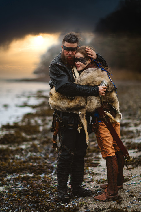 A couple embracing during their Nordic adventure wedding, after booking a Viking wedding package abroad for two