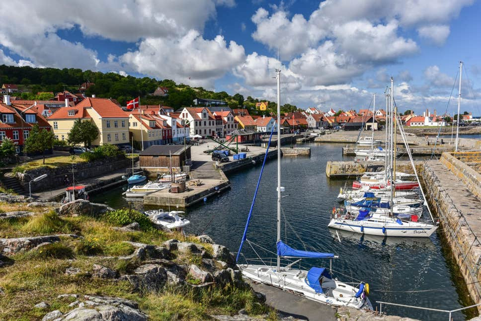 A view to Gudjem harbour where couples eloping for their wedding abroad in Denmark