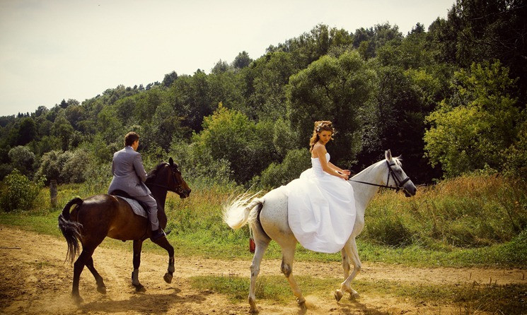 Newlyweds on the horseback during their elopement abroad