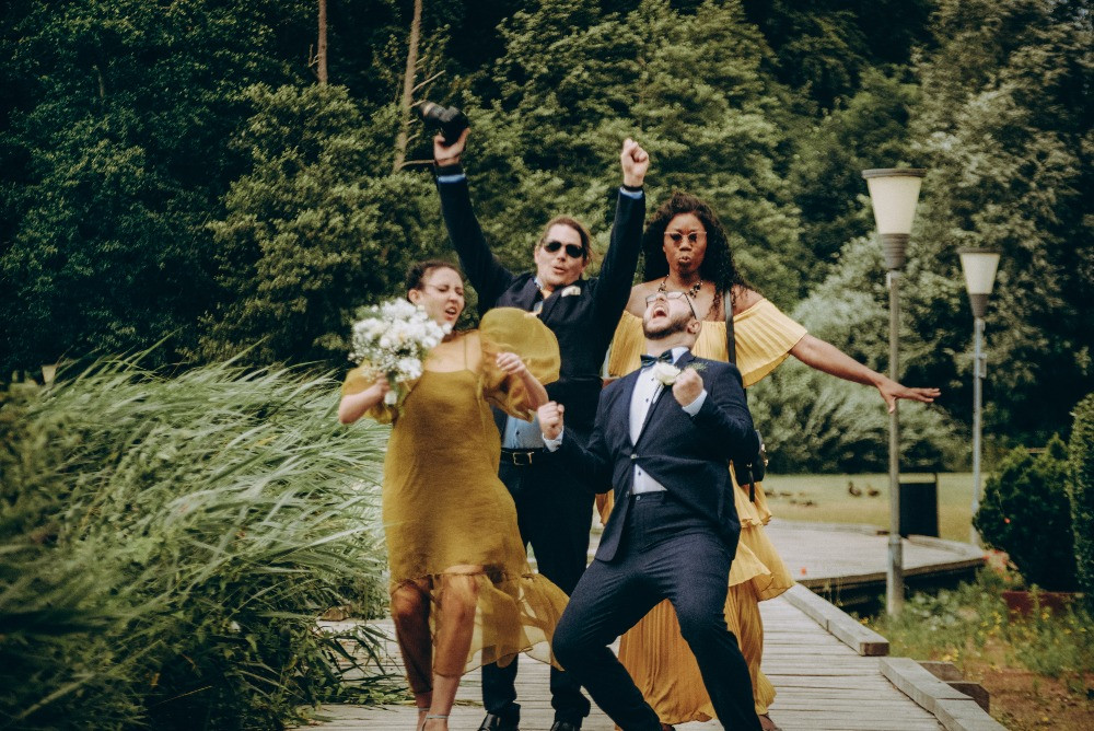 Newly weds with their friends dancing at Maribo lake during their elopement wedding