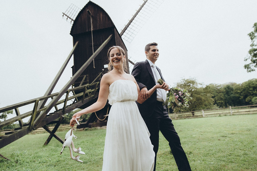 A couple laughing during their open-air museum wedding in Denmark, a charming venue for your small intimate wedding abroad.