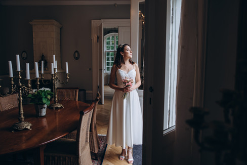 A romantic portrait for a bride during her wedding abroad that the Vindeholme Castle, a top wedding venue offered in our Denmark wedding packages.