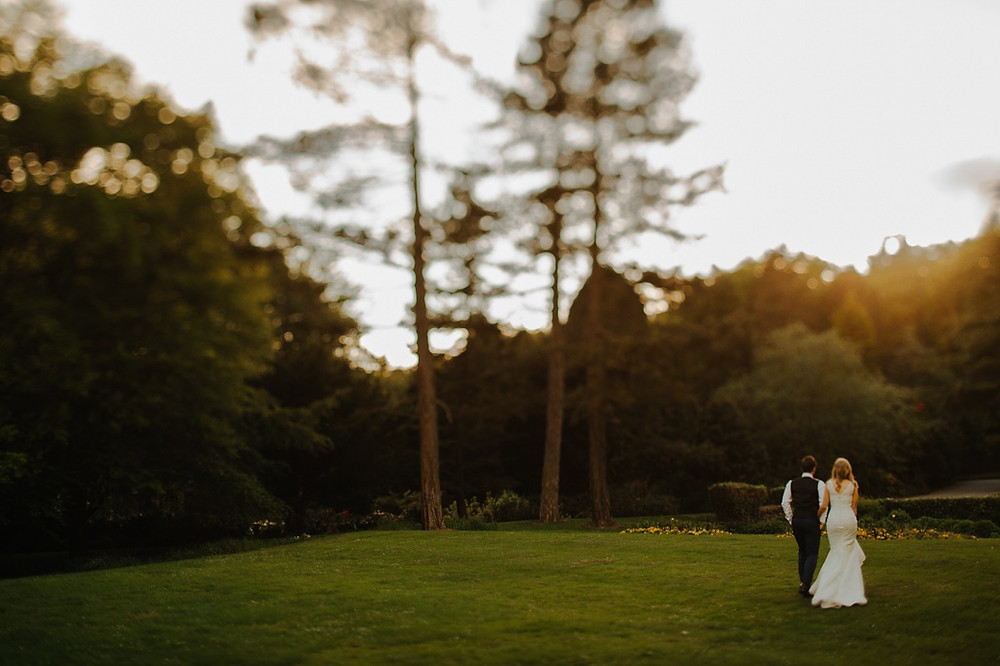 A newlyweds walking in the forest during their romantic elopement in Denmark for two.