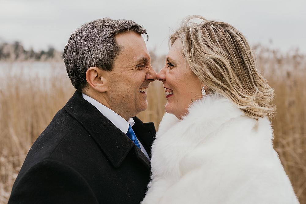 American couple make an escimo kissing while their adventure elopement in Denmark