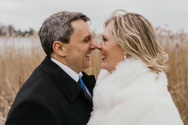 A groom and bride touch each other with nouses during their winter wedding in Denmark