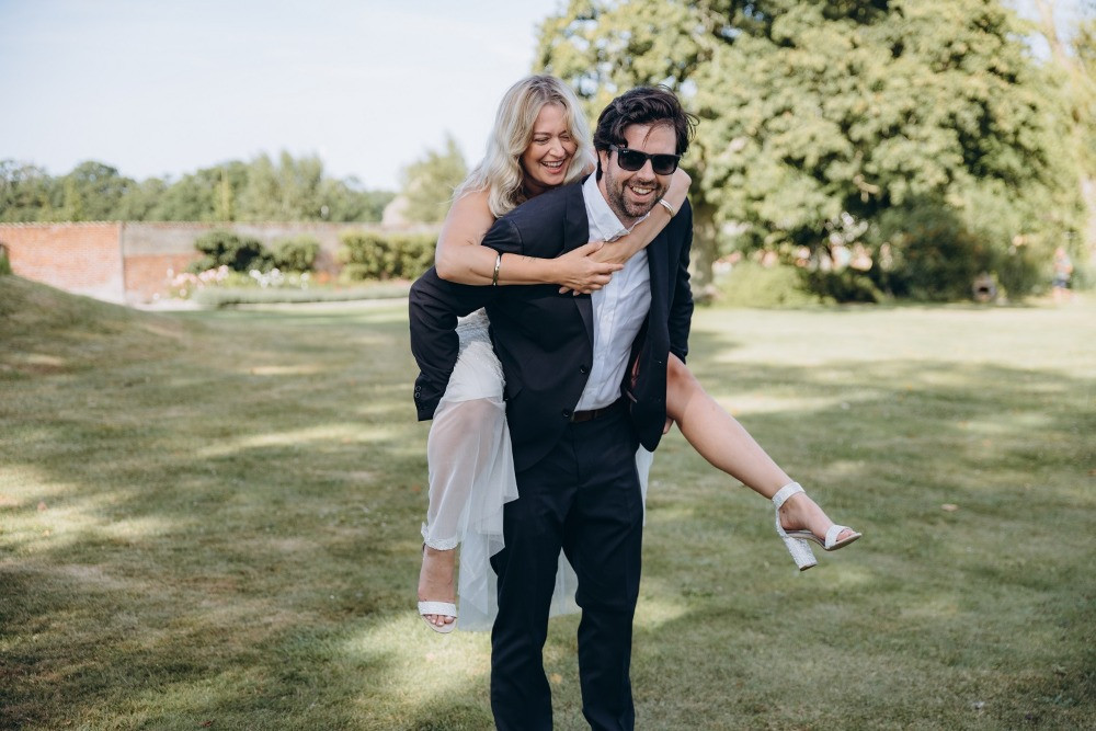 Newlyweds have fun during their adventure wedding in Denmark in the garden