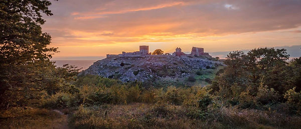Image of the castle ruins on Bornholm Island, one of the best wedding destinations in the world if you're dreaming of a small wedding abroad.