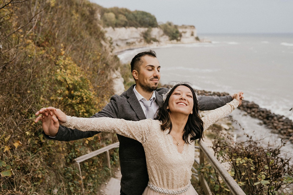 A couple embracing at Stevens Klint thanks to their elopement packages abroad for two.