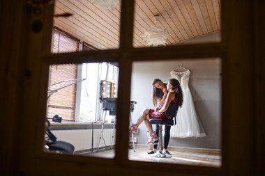 A bride getting her make-up done so she can get married in Denmark after booking our romantic elopement package abroad.