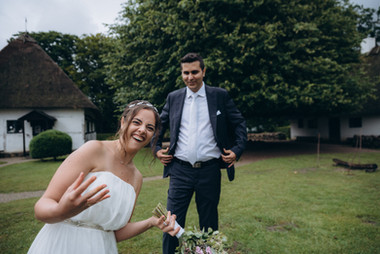 Newlyweds having fun during their eco-style wedding in Denmark