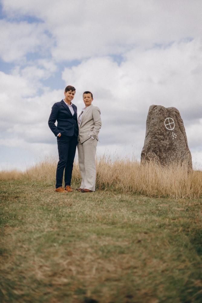 Lesbian couple posing in Viking village during their wedding in Denmark