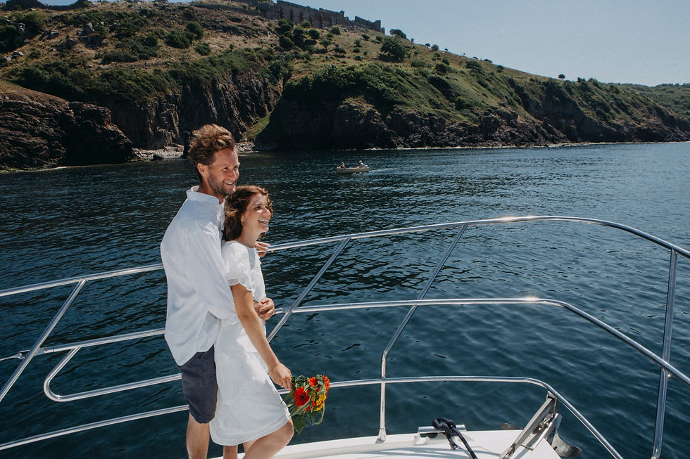 A groom holding his bride on the yacht during their baltic wedding abroad