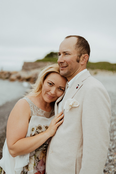 An intimate moment between husband and wife as they enjoy their island wedding adventure in Denmark, also perfect for the renewal of vows abroad.