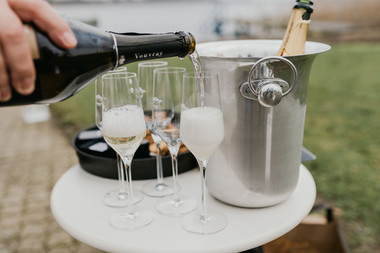 A close up of champagne pouring during a Lolland Island wedding, one of the many details that go into perfecting our Denmark elopement packages.
