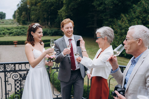 A family toasting during an intimate wedding in Denmark at the Vindeholme Castle.