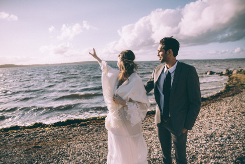 A romantic experience by the beach, newlyweds enjoying their Danish wedding, a magical adventure elopement.
