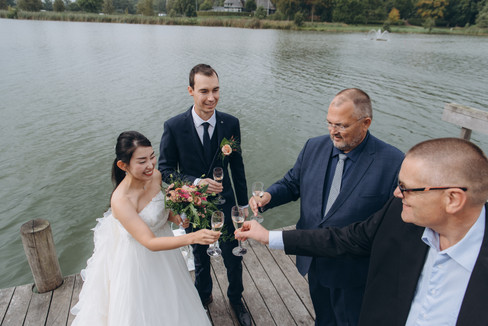 Newlyweds celebrating during their small wedding in Denmark by the Maribo Lake, a top venue for nature lovers
