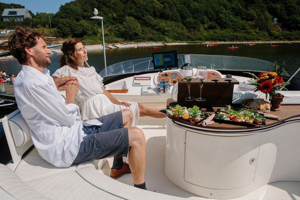 Newlyweds totally relaxed on the yacht during their all inclusive elopement package abroad.