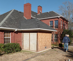 Completing the roof of a Forever Safe Shelter attached to existing home