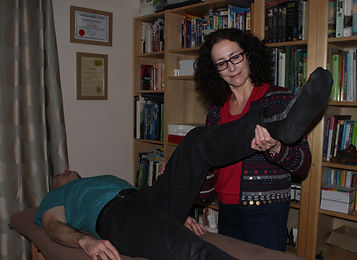 Gail performing a muscle test on a client