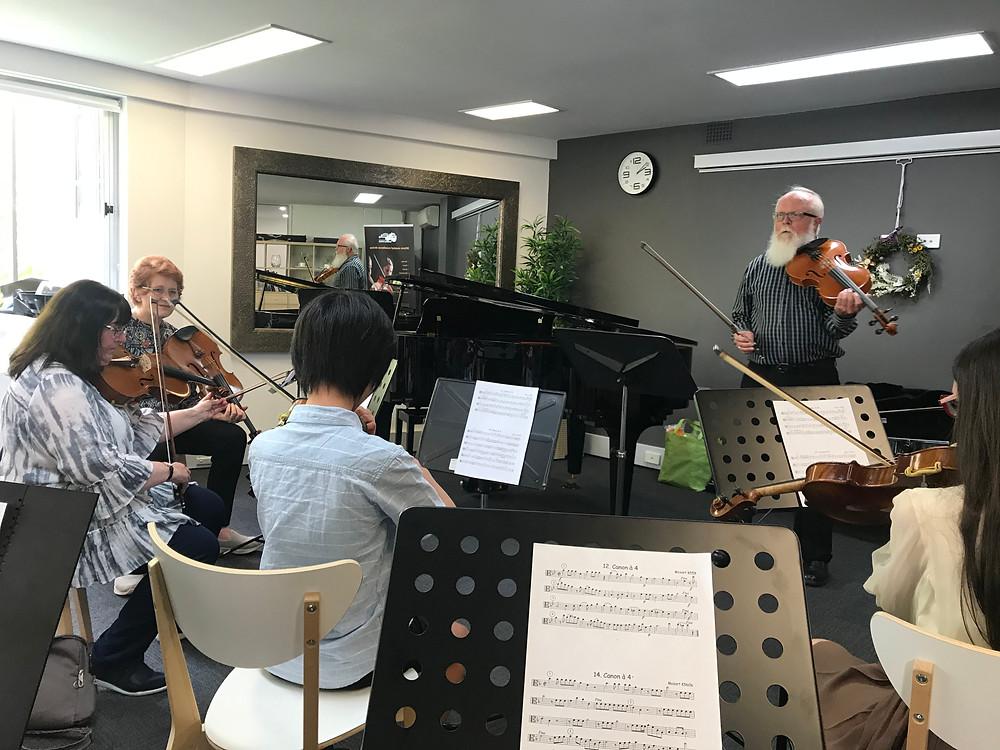 Robert Harris (event organiser) leads viola ensemble