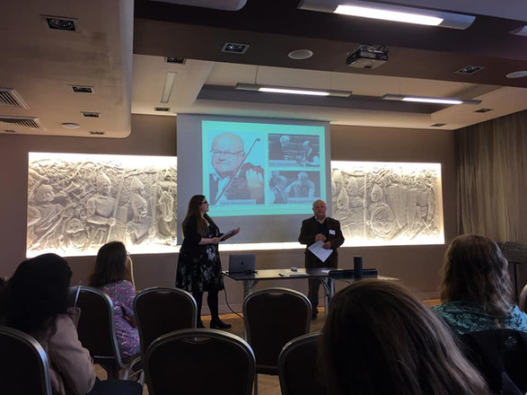 Elyse Dalabakis giving a presentation about Dragatakis' Concerto for Viola at the 46th International Viola Congress in Poland (September 2019). In this photo she's accompanied by Artur Paciorkiewicz, the violist who premiered the work in 1993. Photo supplied by Elyse Dalabakis.