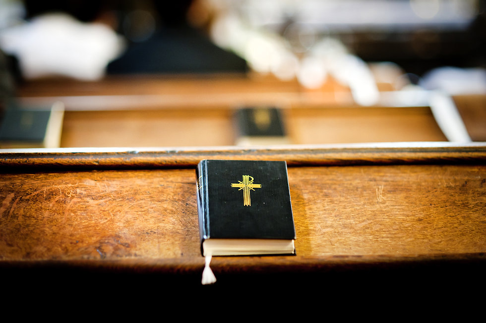 Still photo of bible put on wooden desk