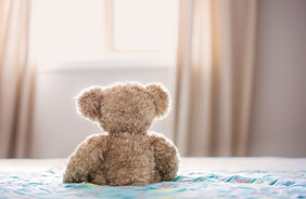 brown-bear-plush-toy-on-bed-860882.jpg