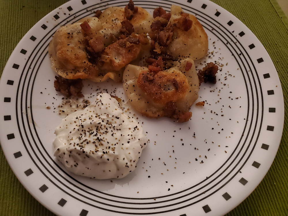 Bob likes his perogy fried with bacon and onions sprinkled over with a big dab of sour cream.