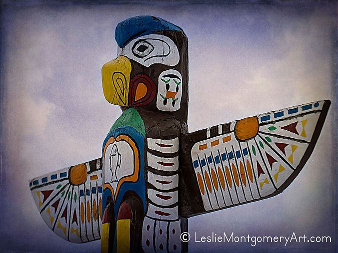 Eagle at the top of a colorful totem pole