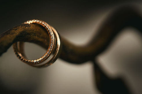 close-up-of-two-gold-wedding-rings-for-a