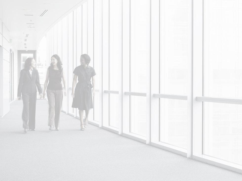 Businesswomen Walking in Hallway_edited.jpg