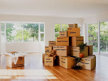 packing-boxes-wrapping-furniture-with-pa