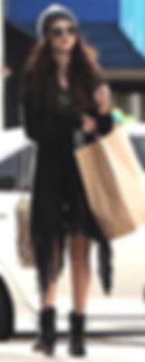 SELENA GOMEZ carries MCFADIN FRINGE BAG