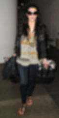 KIM KARDASHIAN carrying a MCFADIN Fringe Bag