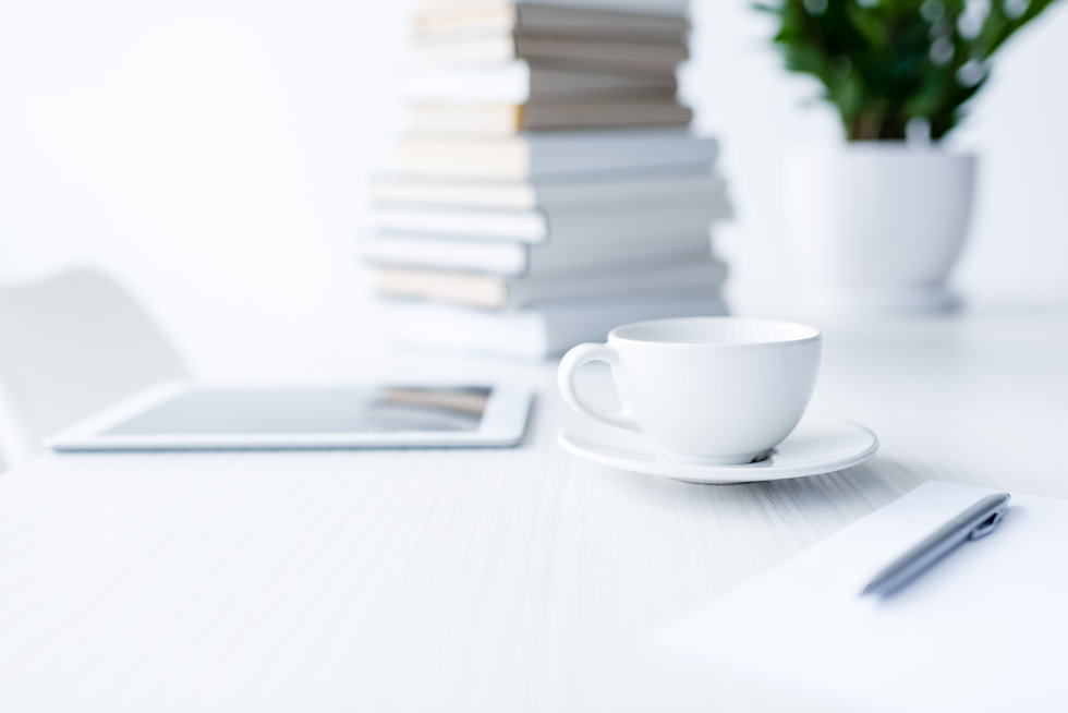 coffee-and-digital-tablet-on-white-desk-