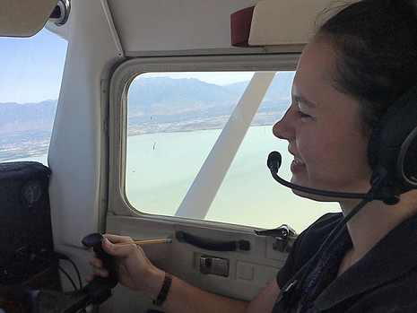Club CFI Alyssa returning from a cross-country flight with one of our members.