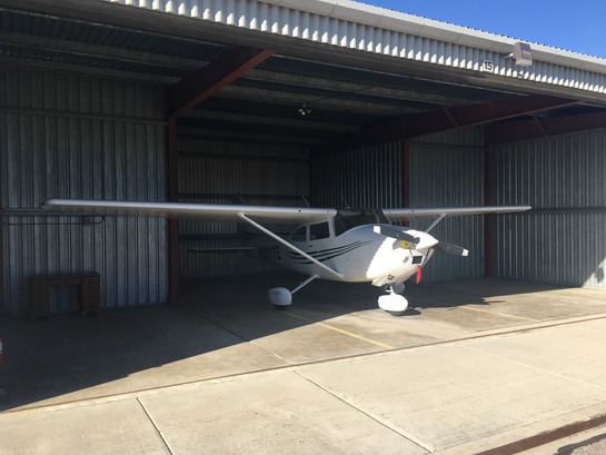Our 182 in her T-Hanger.