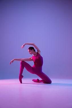 young-graceful-ballet-dancer-isolated-purple-studio-background-neon-light-2.jpg