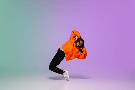 girl-dancing-hip-hop-stylish-clothes-gradient-background-dance-hall-neon-light.jpg