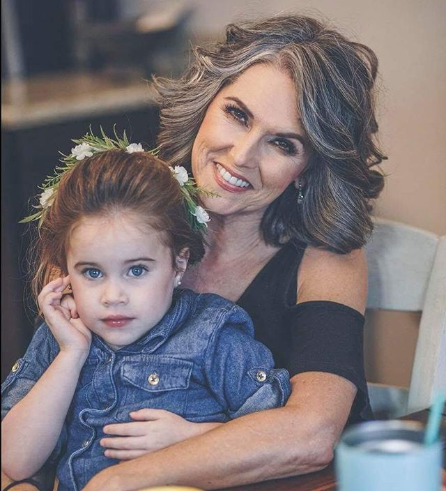 How gorgeous is this mother of the bride and flower girl_ Such a cute photo!! Hair and makeup by us!