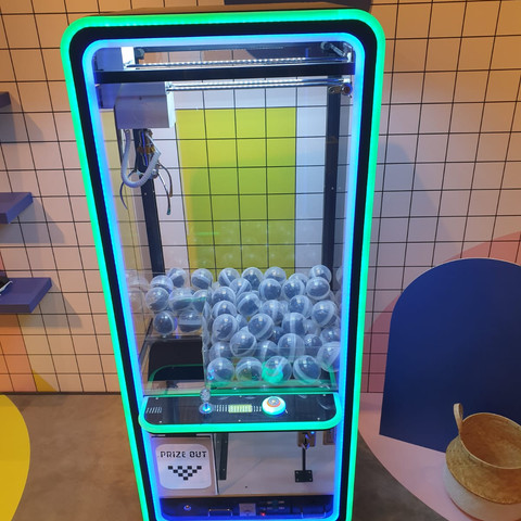 neon-claw-machine-with-toys-rental