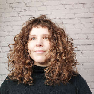 thick_curly_hair_specialist_bangs