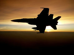 military-jet-silhouette-flying-sunset.jp
